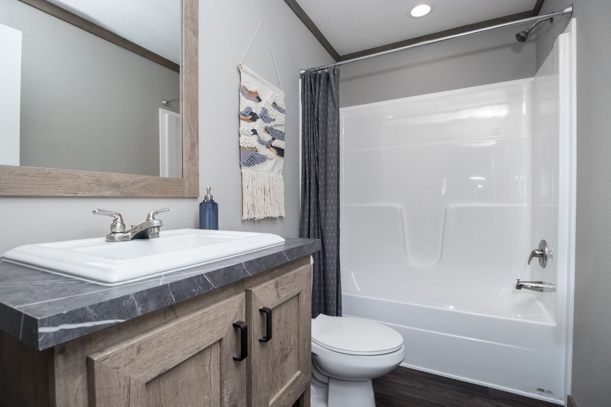 The ISABELLA Guest Bathroom. This Manufactured Mobile Home features 3 bedrooms and 2 baths.